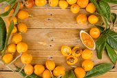 foto of loquat  - Still life with freshly picked loquats and homemade marmalade - JPG