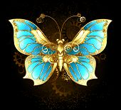 picture of brooch  - mechanical butterfly brass and gold with wings decorated with blue glass and gears - JPG