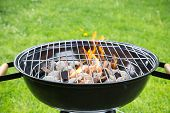image of ember  - Empty grill on garden with burning embers - JPG