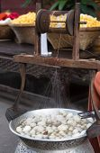 stock photo of silk worm  - silkworm boil pot, a silk string processing ** Note: Soft Focus at 100%, best at smaller sizes ** Note: Visible grain at 100%, best at smaller sizes - JPG