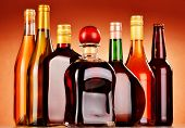 foto of ethanol  - Bottles of assorted alcoholic beverages including beer and wine - JPG