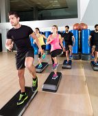 pic of step aerobics  - Cardio step dance people group at fitness gym training workout - JPG