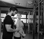 picture of pulley  - cable pulley system personal trainer man and woman learning at fitness gym - JPG