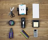 pic of dispenser  - Overhead view of office materials placed on rustic wood - JPG