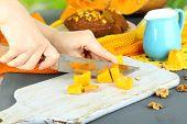 foto of pumpkin pie  - Cooking pumpkin pie on wooden table on natural background - JPG