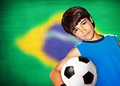 stock photo of preteen  - Cute boy playing football - JPG