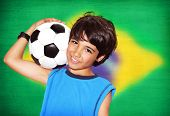 stock photo of preteens  - Cute boy playing football - JPG
