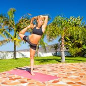 pic of natarajasana  - Woman doing beautiful natarajasana yoga pose outdoors in garden summer sunny nature - JPG