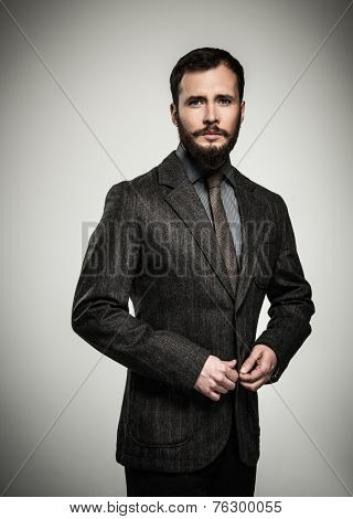 Handsome man with beard wearing jacket