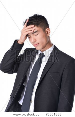 Portrait of depressed young businessman