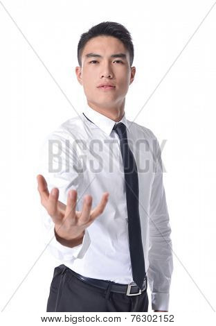 Businessman in a suit holds out his hand with the palm facing upwards isolated on white background