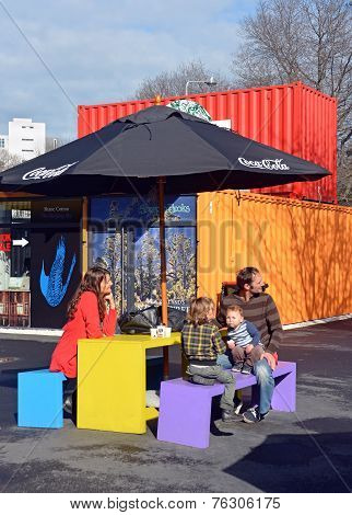 Family In Spring At The Restart Container Shops In Christchurch.