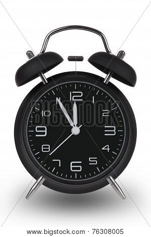 Black Alarm Clock With Hands At 5 Minutes Till 12