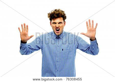 Portrait of angry young man with raising hands up