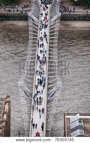 LONDON - 09 JUNE 2013: Random People Passing at Famous Millennium Bridge at River Thames in London. Captured in Aerial View  on 09 June 2013.