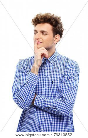 Portrait of a young pensive man isolated on a white background