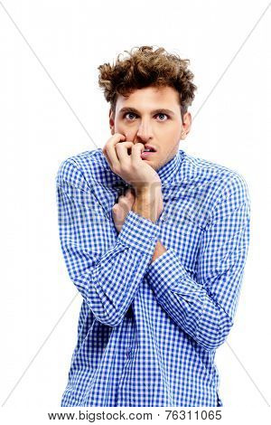Young handsome man afraid isolated on white background