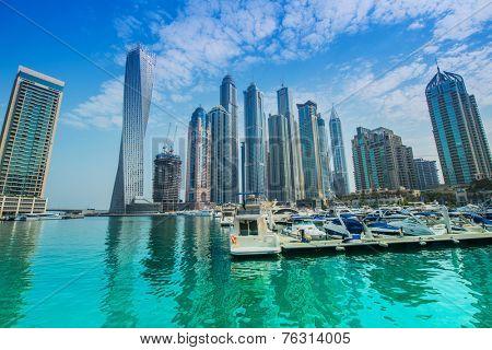 Dubai - AUGUST 9, 2014: Dubai Marina district on August 9 in UAE, Dubai. Dubai Marina district is a popular residential and business area.