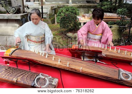 Japanese women playing the koto