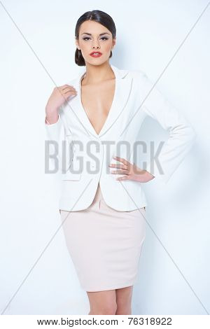 Close up Gorgeous Young Woman Wearing White and Light Pink Corporate Attire   Showing her Cleavage While Posing in Front of the Camera.Isolated on White Background.