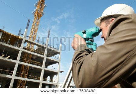 Surveyor With Transit Level Equipment