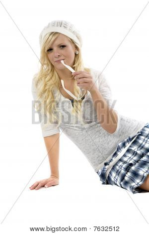 Girl In Blue Skirt With Glasses In Mouth