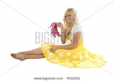 Girl In Yellow Dress Holding Pink Shoes