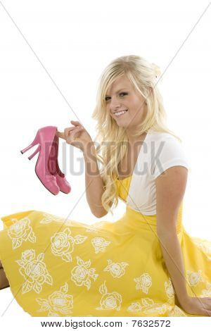 Girl In Yellow Dress Pink Shoes In Hand