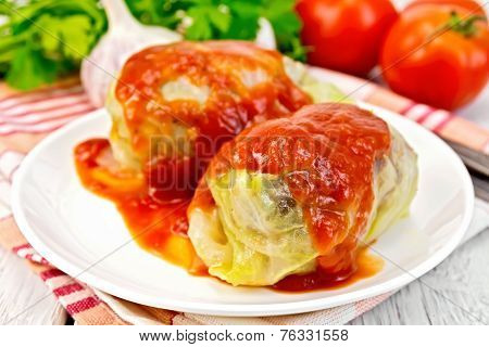Cabbage stuffed in plate on board