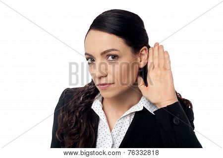 Business Woman With Hand To Ear