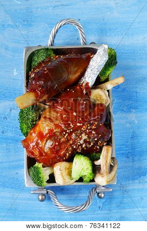 Meat shin baked with tomato sauce with vegetables garnish