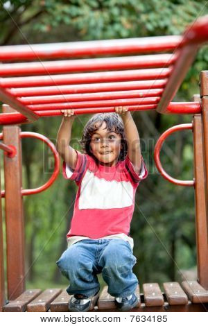Kid Playing On The Monkey Bars