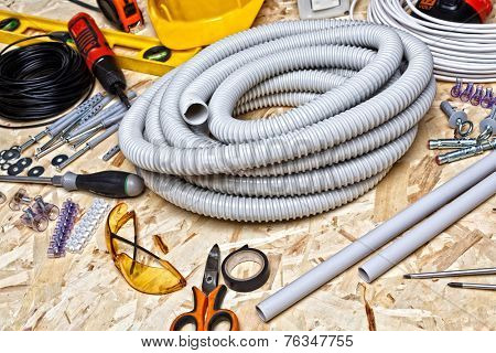 electrician tools on osb wood background
