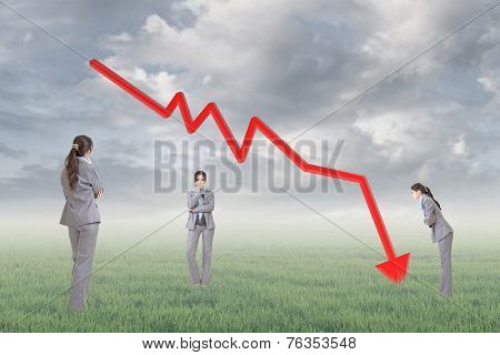 Business woman with downward arrow, concept of decrease, down, negative etc.