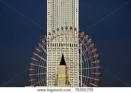 Sky Scraper And Ferris Wheel