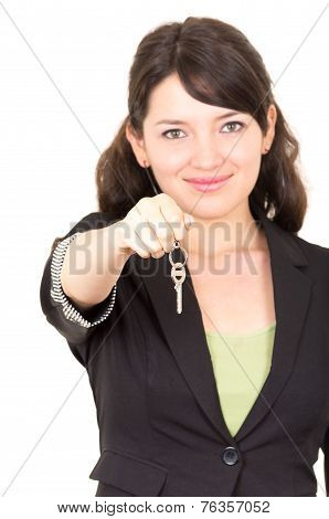 portrait of beautiful young woman holding key