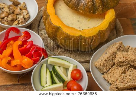 Cheese Fondue In A Roasted Pumpkin With Bread And Vegetables