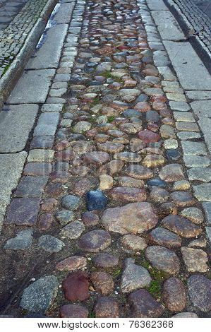 Cobbled street from the gutter
