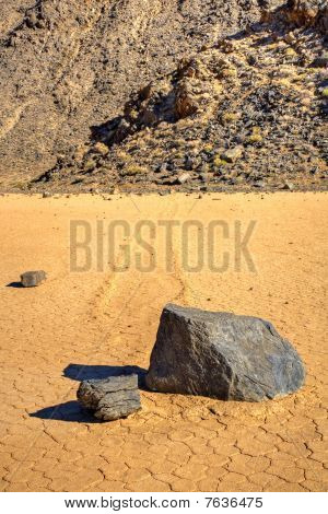 Sliding Stones On Dry Lakebed