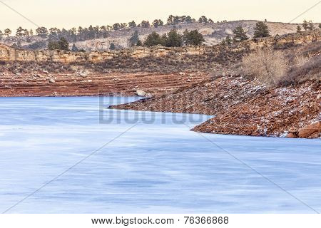 frozen lake with red cliffs - Horsetooth Reservoir near Fort Collins, Colorado