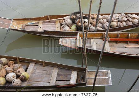 Asian Boats Carrying Fruits