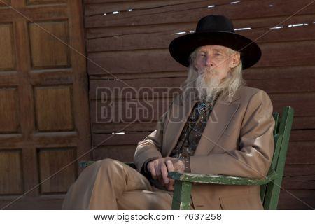 Senior Man In Western Clothing