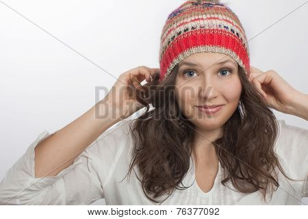 Smiling Girl Holding  Own Knitted Hat