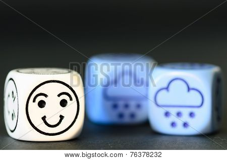 Concept Of Happy Snow / Winter Weather - Emoticon And Weather Dice On Black Background