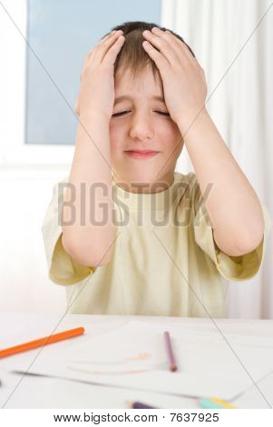 Upset Boy With A Pencil