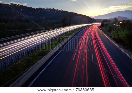 Light Beams Of Vehicles On Highway.