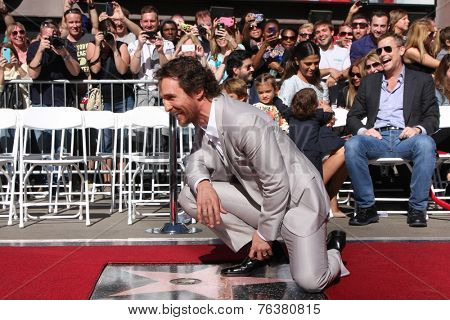 LOS ANGELES - NOV 17:  Matthew McConaughey, family in background at the Matthew McConaughey Hollywood Walk of Fame Star Ceremony at the Hollywood & Highland on November 17, 2014 in Los Angeles, CA