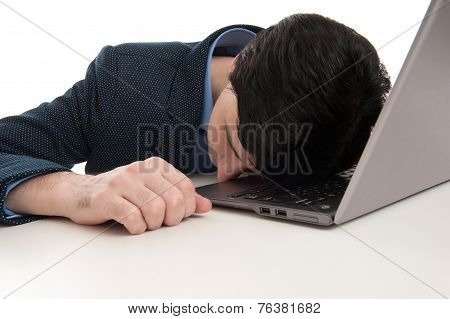 Overworked Businessman Sleeping On His Laptop