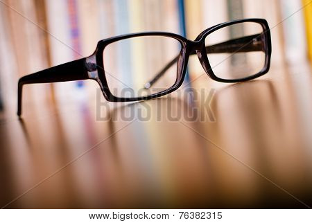 Close Up Eyeglasses On Wooden Table