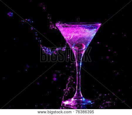 colourful cocktail on the black background. Party club entertainment. Mixed light
